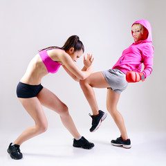two sport boxing young woman, studio