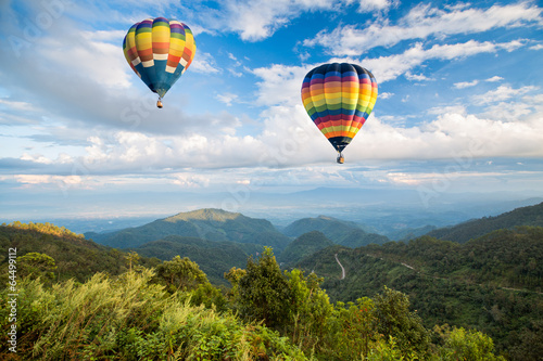 Hot air balloon over the mountain - 64499112