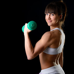sport girl doing exercise with dumbbells, fitness young woman st