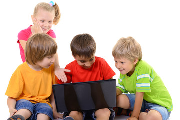 happy children playing and learning with laptop, over white