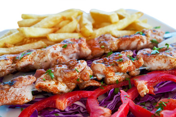Meat grilled on skewers with chips