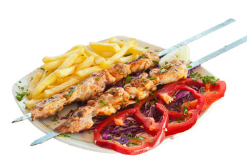 shish kebab on skewers with chips