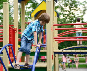 children playing on  playground in summer outdoor park