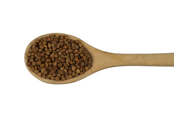 wooden spoon full of buckwheat