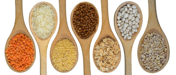 wooden spoons full of grains