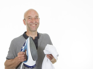 Man holding an iron and creased shirt