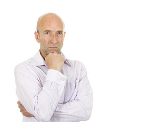 Man in pale shirt stood thinking