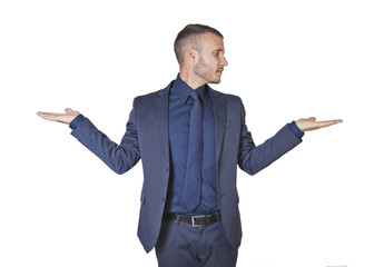 Businessman making a balance gesture