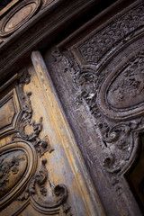 Old used door of a French mansion