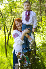mother with child in the Ukrainian national clothes