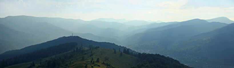 Panoramic view of summer Carpathian mountains in evening