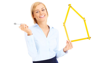 Real estate agent with keys and measure