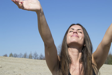Woman - outstretched arms - happiness - sunshine