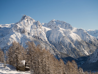 Bright sunlight with the panorama of the snow-covered Piz Lischa