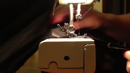Close up on a sewing machine showing process