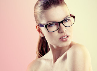 Portrait of young pretty female wearing stylish glasses