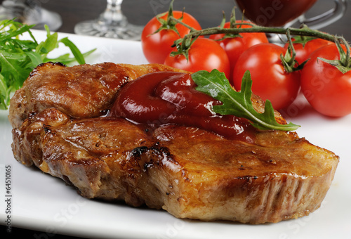 Pork steak with ketchup