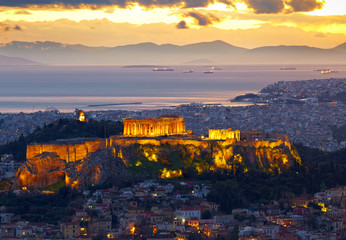 Athens, Greece. After sunset. Parthenon and Herodium constructio