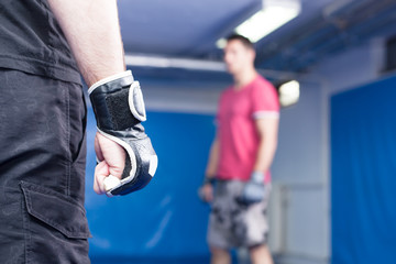 fighter wearing black gloves during mma training