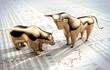 Leinwandbild Motiv Bulle und Bär auf Zeitungsseite