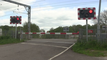 Barrier going up at a level crossing.