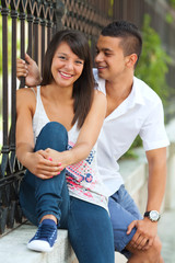 Young couple  smiling and relaxing in the city street