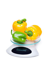 Kitchen weight scale with peppers.