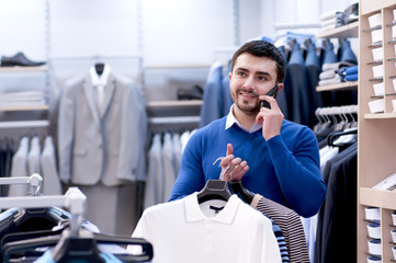 Man talking on the phone in the store.