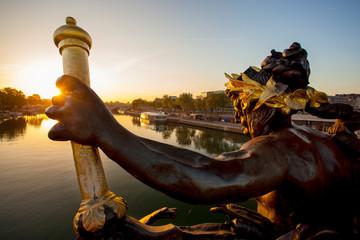 Bridge of Alexander III in Paris against sunset in France
