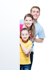 Happy young smiling family with  banner.