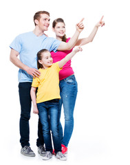 Happy young family with kid pointing finger up.