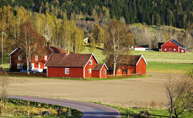 red farm 17th century set in old rural landscape,Sweden