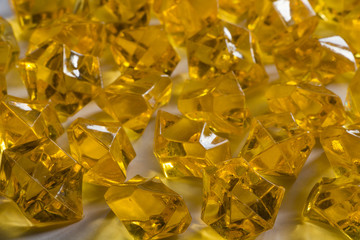 Granules of the transparent yellow plastic