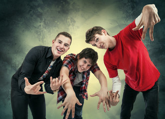 Three young man in fun hip hop poses