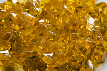 Granules of the transparent yellow plastic in the form of jewels