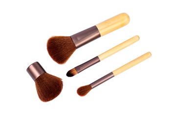 Wooden cosmetic brushes. Isolated