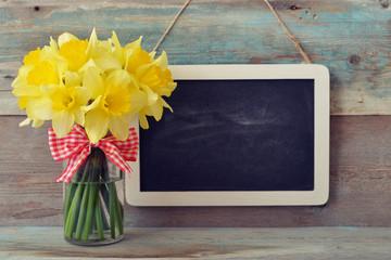 Framed blackboard with daffodils