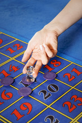 Roulette tokens and numbers and croupier hand