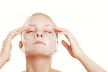 Girl woman in facial peel off mask. Skin care.