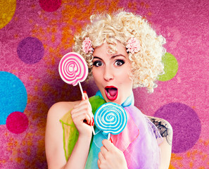 ladybabe 11_2-girl with lollipops in front of a colored wall