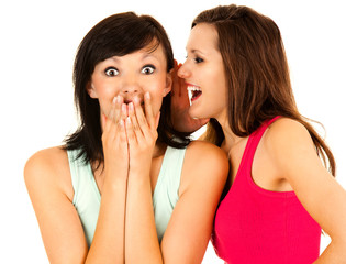 gossip, young woman whispering to the friends ear
