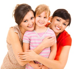 two women and girl, smiling, hugging each other