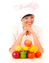 female cook in uniform with fruit and vegetables