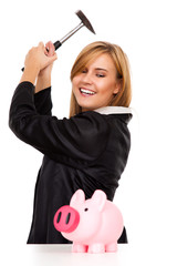 business woman with hammer and piggy bank