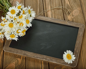 Writing board and daisies