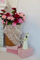 Корзина цветов у стены