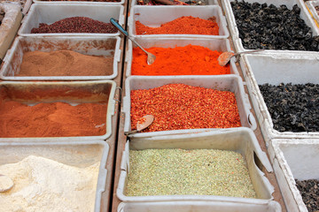 Colorful spices displayed in an informal market