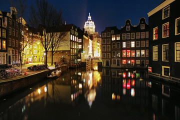 Evening view on the channels of Amsterdam and St. Nicolas Church