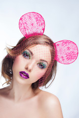 Beautiful young face. fashion multicolored makeup.