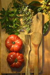 ripe tomatoes, parsley bay leaf and rosemary vintage